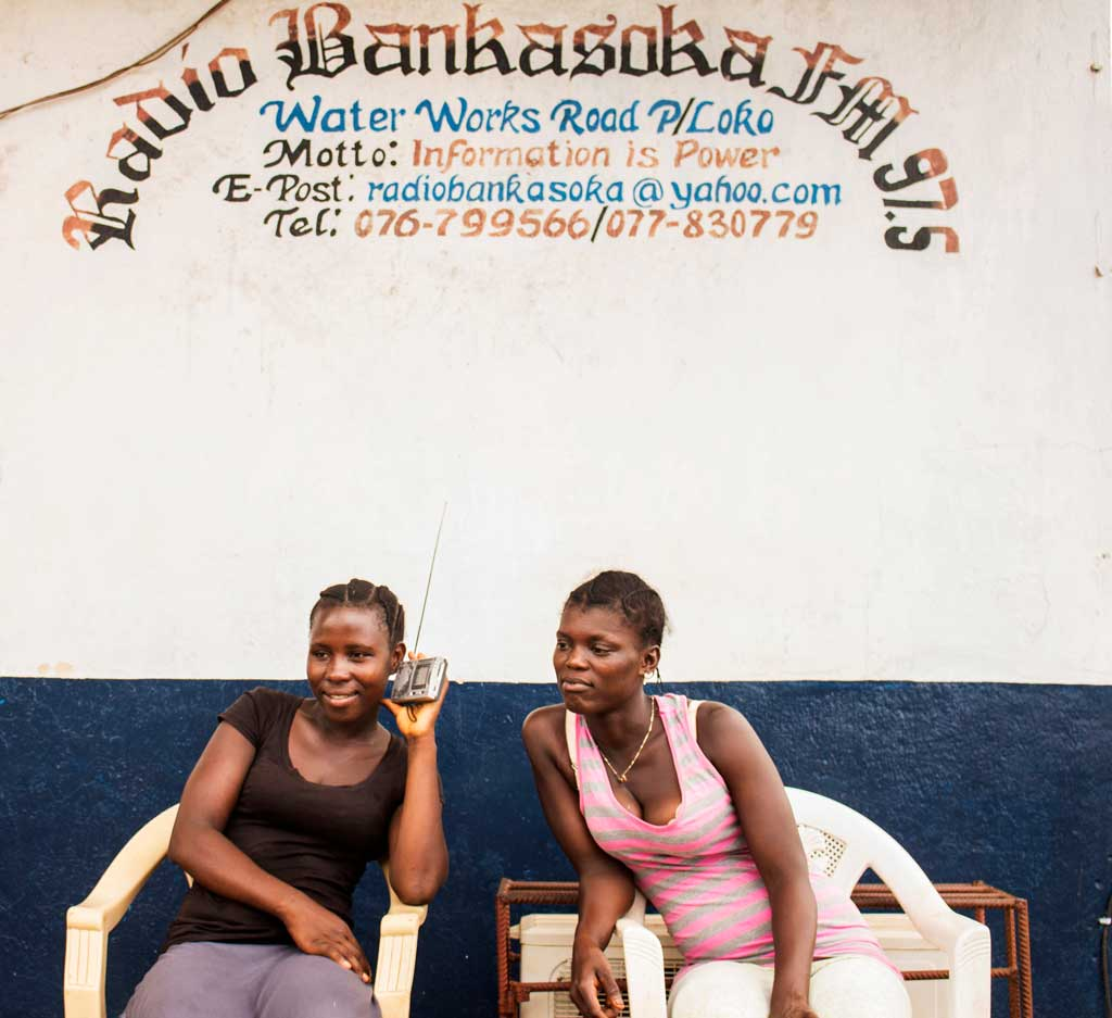 Girls listening to Radio Banka Soka FM97 in Port Loko District, Sierra Leone