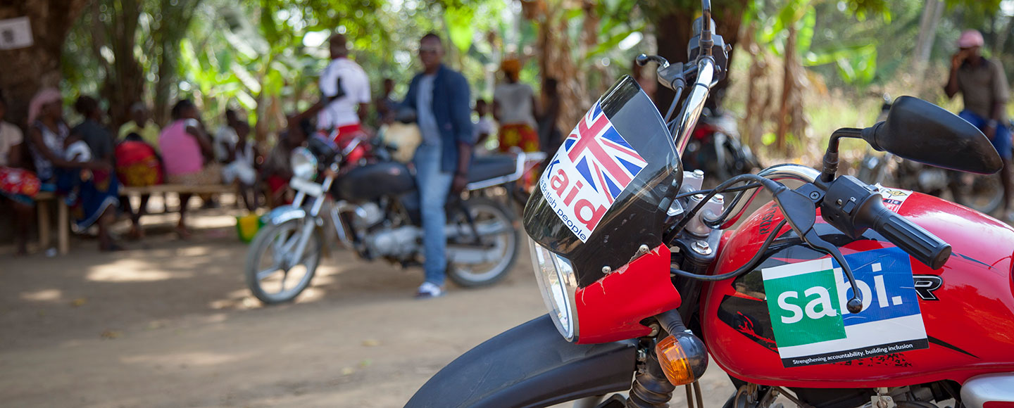 UK aid logo on a motorbike